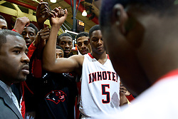 Imhotep Head Coach Andre Noble and the Panthers before the game. (Bas Slabbers/for NewsWorks)