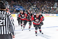 fKELOWNA, CANADA - NOVEMBER 9: Kale Clague #11 of Team WHL celebrates a goal against the Team Russia on November 9, 2015 during game 1 of the Canada Russia Super Series at Prospera Place in Kelowna, British Columbia, Canada.  (Photo by Marissa Baecker/Western Hockey League)  *** Local Caption *** Kale Clague;