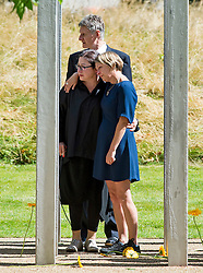 © Licensed to London News Pictures. 07/07/2015. London, UK. Survivor GILL HICKS (far right) with Family of those who lost their lives and survivors of the attack lay flower at the memorial during the service. A memorial service in Hyde Park London on the 10th anniversary of the 7/7 bombings in London. The event is attended by Prince William, survivors of the attack and family of those who lost their lives. Photo credit: Ben Cawthra/LNP