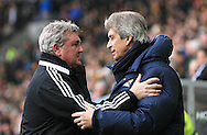 Steve Bruce Manager (left) of Hull City greets Manuel Pellegrini manager of Manchester City during the Barclays Premier League match at the KC Stadium, Kingston upon Hull<br /> Picture by Richard Gould/Focus Images Ltd +44 7855 403186<br /> 15/03/2014
