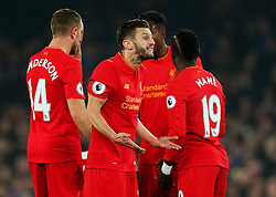 Adam Lallana of Liverpool reacts after giving away a free kick - Mandatory by-line: Matt McNulty/JMP - 19/12/2016 - FOOTBALL - Goodison Park - Liverpool, England - Everton v Liverpool - Premier League