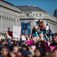 A crowd gathers at Civic Center Plaza during a rally preceding the start of the Women's March in San Francisco, California on January 20, 2018. (Photo by Philip Pacheco)