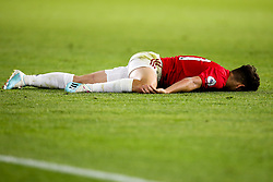 Daniel James of Manchester United lies on the floor injured - Mandatory by-line: Robbie Stephenson/JMP - 19/08/2019 - FOOTBALL - Molineux - Wolverhampton, England - Wolverhampton Wanderers v Manchester United - Premier League