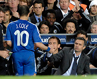 Photo: Richard Lane.<br />Chelsea v Liverpool. UEFA Champions League. Semi Final, 1st Leg. 25/04/2007. <br />Chelsea manager Jose Mourinho shakes hands with goal scorer, Joe Cole as he is substitited.