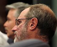 John Shutway of Urbana (left) and Steve Watring of Kettering watch the Republican debate in Arizona, Wednesday, February 22, 2012.
