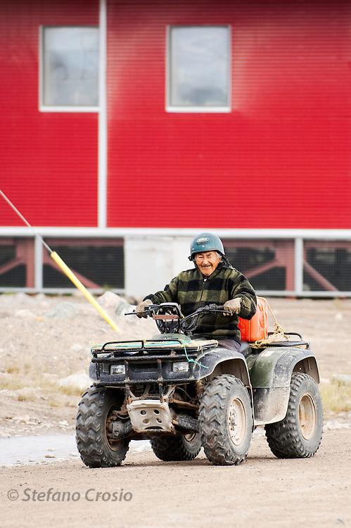 CANADA, Nunavut<br /> Old Inuit man on quad