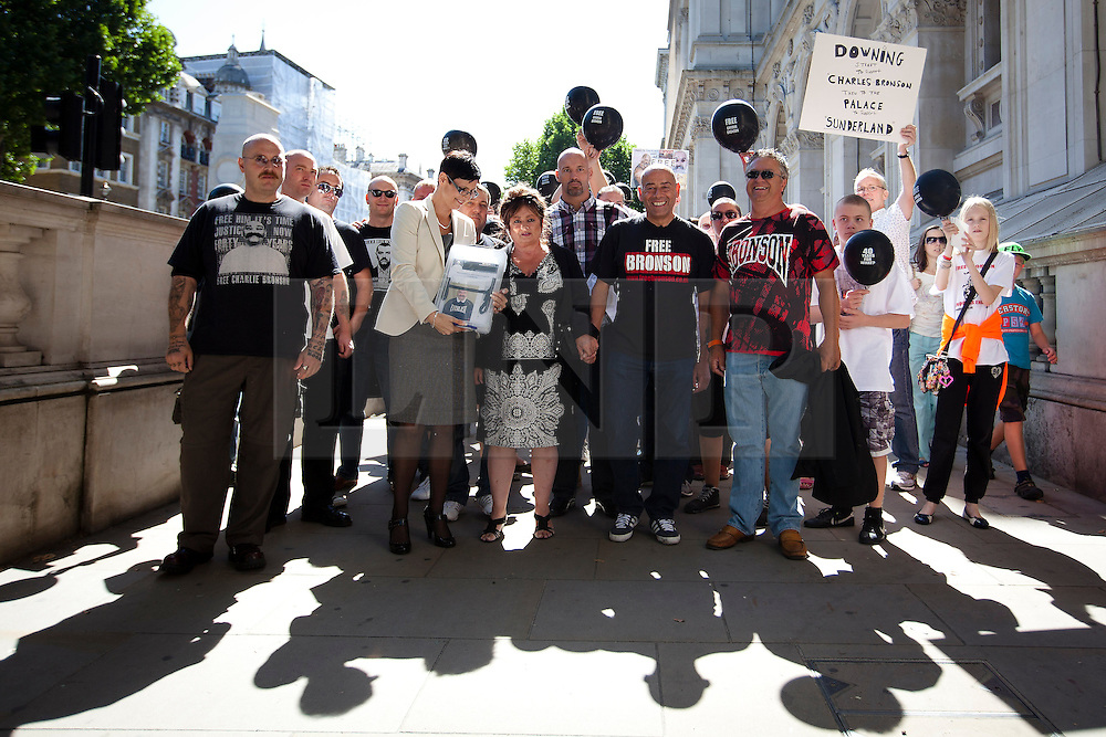 "© Licensed to London News Pictures. 31/08/2013. London, UK. Lorraine Etherington (front 2L), Lorraine Salvage (front 3L) and Mark Peterson (front 4L), sister, cousin and brother of of prisoner Charles Bronson, are seen with other friends and relatives before handing in a petition for his release to Number 10 Downing Street in London today (31/08/2013). Often referred to in the British press as the ""most violent prisoner in Britain"", Bronson is currently being held on a life sentence in Wakefield High-Security Prison. Photo credit: Matt Cetti-Roberts/LNP"
