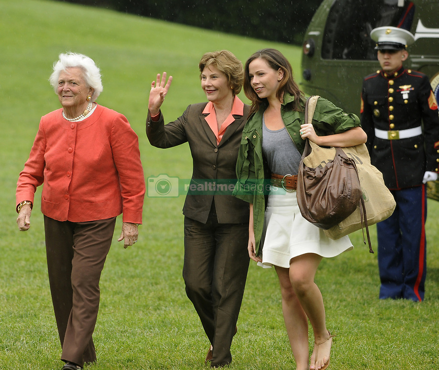 May 11, 2008 - Washington, District of Columbia, United States of America - First lady Laura Bush waves to onlookers as she walks with former first lady Barbara Bush (L) and daughter Barbara as they arrive at the White from a weekend at the Crawford, Texas ranch, 11 May 2008 in Washington, DC.  United States President George W. Bush, whose daughter Jenna married Henry Hager at the ranch, described the experience as 'spectacular' and 'it's all we could have hoped for'.   .Credit: Mike Theiler / Pool via CNP (Credit Image: © Mike Theiler/CNP via ZUMA Wire)