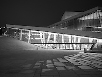 Black and white image of Oslo Opera House at night