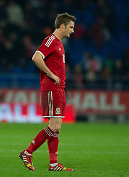 16.11.2013, Cardiff City Stadium, Cardiff, WAL, Fussball Testspiel, Wales vs Finnland, im Bild Wales' Andy King shows, look of dejection at full time // during the international friendly match between Wales and Finland at the Cardiff City Stadium in Cardiff, Great Britain on 2013/11/17. EXPA Pictures © 2013, PhotoCredit: EXPA/ Propagandaphoto/ Kieran McManus<br /> <br /> *****ATTENTION - OUT of ENG, GBR*****