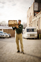 A driver holds a box of rolls at the West Philadelphia-based Amoroso bakery. The Amoroso Rolls are the gold standard bread for Philadelphia Cheesteak sandwiches.