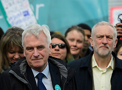 © Licensed to London News Pictures. 26/04/2016. London, UK.  Shadow chancellor JOHN MCDONNELL (left) and Labour leader JEREMY CORBYN (right) join Junior doctors and supporters as they stage a protest in Westminster, London as part of all-out strike action against planned changes to their contracts. The march starts at St Thomas Hospital and ends outside the Department of Health in Whitehall..  Photo credit: Ben Cawthra/LNP