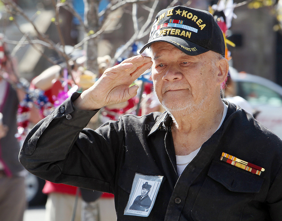 (Boston, MA - 4/29/13) World War II veteran Chief Raymond Moye of Jamaica Plain makes a salute to the bombing victims at the Marathon Memorial in Copley Square, Monday, April 29, 2013. Staff photo by Angela Rowlings.