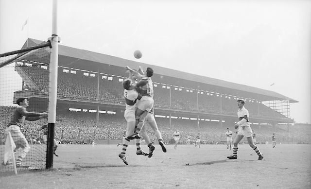 Derry's T. Quinn and Kerry's G. O' Donnel jump for the ball during the All Ireland Minor Gaelic football final Derry v. Kerry in Croke park on the 26th September 1965.