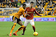 Wolverhampton Wanderers defender Dominic Iorfa and Nottingham Forest defender Daniel Pinillos tussle for the ball during the Sky Bet Championship match between Wolverhampton Wanderers and Nottingham Forest at Molineux, Wolverhampton, England on 11 December 2015. Photo by Alan Franklin.