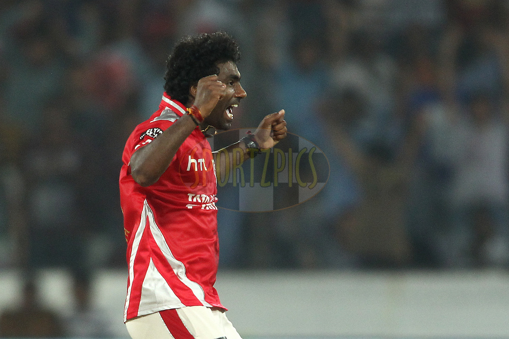 Parvinder Awana of the Kings XI Punjab celebrates getting Chennai Super Kings captain MS Dhoni wicket  during the second semi final match of the Oppo Champions League Twenty20 between the Kings XI Punjab and the Chennai Superkings held at the Rajiv Gandhi Cricket Stadium, Hyderabad, India on the 2nd October 2014<br /> <br /> Photo by:  Shaun Roy / Sportzpics/ CLT20<br /> <br /> <br /> Image use is subject to the terms and conditions as laid out by the BCCI/ CLT20.  The terms and conditions can be downloaded here:<br /> <br /> http://sportzpics.photoshelter.com/gallery/CLT20-Image-Terms-and-Conditions-2014/G0000IfNJn535VPU/C0000QhhKadWcjYs