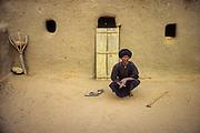 Nioro du Sahel, a mullah near is poor mud mosque.