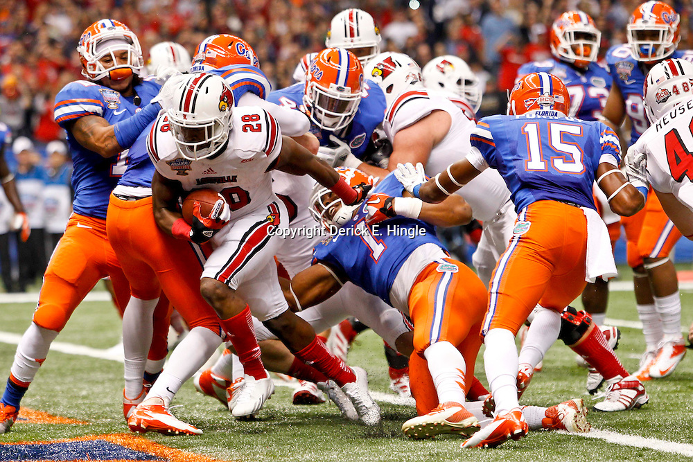 Jan 2, 2013; New Orleans, LA, USA; Louisville Cardinals running back Jeremy Wright (28) runs for a touchdown against the Florida Gators during the first quarter of the Sugar Bowl at the Mercedes-Benz Superdome.  Mandatory Credit: Derick E. Hingle-USA TODAY Sports