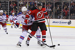 Jan 31; Newark, NJ, USA; New Jersey Devils right wing David Clarkson (23) skates with the puck while being defended by New York Rangers defenseman Ryan McDonagh (27) during the second period at the Prudential Center.