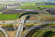 Nederland, Noord-Brabant, Gemeente Moerdijk, 23-10-2013; Infrabundel, combinatie van autosnelweg A16 gebundeld met de spoorlijn van de HSL ter hoogte van Knooppunt Zonzeel. <br /> Combination of motorway A16 and the HST railroad, Brabant (southern Netherlands)<br /> luchtfoto (toeslag op standard tarieven);<br /> aerial photo (additional fee required);<br /> copyright foto/photo Siebe Swart