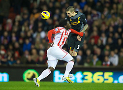STOKE-ON-TRENT, ENGLAND - Boxing Day Wednesday, December 26, 2012: Liverpool's Daniel Agger in action against Stoke City's Kenwyne Jones during the Premiership match at the Britannia Stadium. (Pic by David Rawcliffe/Propaganda)