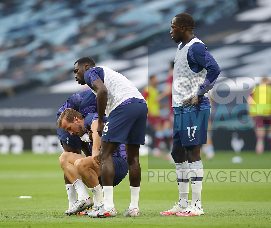 Harry Kane of Tottenham is helped up following a tackle during warm up during the Premier League match at the Tottenham Hotspur Stadium, London. Picture date: 23rd June 2020. Picture credit should read: David Klein/Sportimage