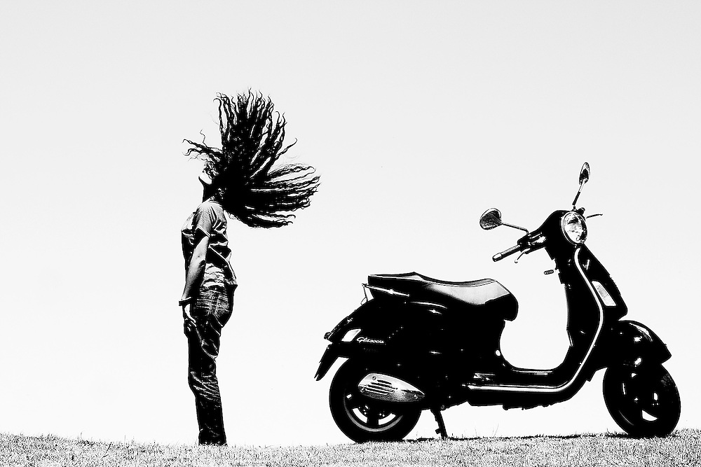 The Italian &amp; Indian<br /> The iconic Vespa is seen against an Indian lady, Great Ocean Road, Australia