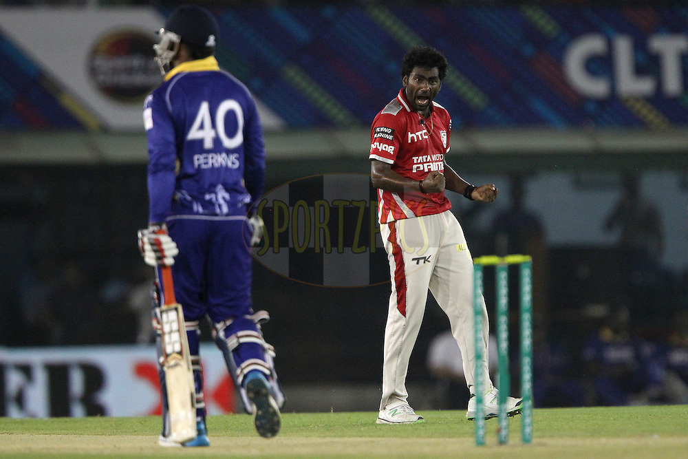 Parvinder AWANA  of the Kings XI Punjab celebrates the wicket of William PERKINS of the Barbados Tridents  during match 5 of the Oppo Champions League Twenty20 between the Kings XI Punjab and the Barbados Tridents held at the Punjab Cricket Association Stadium, Mohali, India on the 20th September 2014<br /> <br /> Photo by:  Ron Gaunt / Sportzpics/ CLT20<br /> <br /> <br /> Image use is subject to the terms and conditions as laid out by the BCCI/ CLT20.  The terms and conditions can be downloaded here:<br /> <br /> http://sportzpics.photoshelter.com/gallery/CLT20-Image-Terms-and-Conditions-2014/G0000IfNJn535VPU/C0000QhhKadWcjYs