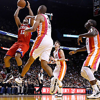 21 January 2012: Philadelphia Sixers shooting guard Evan Turner (12) takes a jumpshot over Miami Heat small forward Shane Battier (31) during the Miami Heat 113-92 victory over the Philadelphia Sixers at the AmericanAirlines Arena, Miami, Florida, USA.
