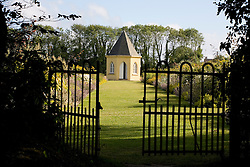 Gates leading to herbaceous borders and shell house at Ballymaloe