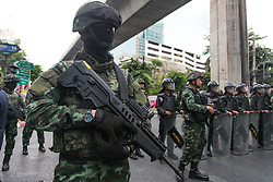 © Licensed to London News Pictures. 24/05/2014. An armed thai army officer awaits a group of anti-coup protestors following a Anti-Coup protest in Bangkok Thailand. The Royal Thai army announced a Military coup and have imposed a 10pm curfew.  Photo credit : Asanka Brendon Ratnayake/LNP