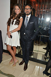 HANI FARSI and MICHELLA FILIPOWITZ at a reception hosted by The Rake Magazine and Claridge's to celebrate London Collections 2015 held at Claridge's, Brook Street, London on 8th January 2015.