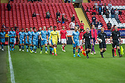 The two teams enter the pitch during the EFL Cup match between Charlton Athletic and Forest Green Rovers at The Valley, London, England on 13 August 2019.