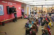 Michelle Poe, Director of Education, talks with students from Westfield Elementary School at the African American Museum of Iowa in Cedar Rapids on Friday, March 22, 2013.