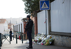 """Police outside  The """"Ozar Hatorah"""" Jewish school  on March 20, 2012 in Toulouse, southwestern France. The bodies of three French-Israeli children and a Jewish teacher killed in a gun attack began their journey Tuesday from the school where they died to their burial in Israel..The bodies were due to be flown from Paris Charles de Gaulle airport later Tuesday for a funeral in Israel. Photo by i-Images"""