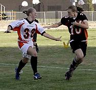 Junior Keesha Hardwick (33) tries to grab the yellow flag of senior Katie Skaleski (10) during the 3rd Annual Powderpuff Challenge, the junior girls (class of 2008) against the senior girls (class of 2007.)