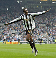 Photo: Andrew Unwin.<br />Newcastle United v West Bromwich Albion. The Barclays Premiership. 22/04/2006.<br />Newcastle's Shola Ameobi celebrates scoring his team's third goal, and his second.