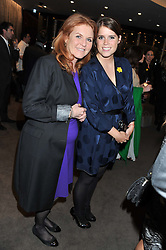 Left to right, SARAH, DUCHESS OF YORK and PRINCESS EUGENIE OF YORK at the launch of Samsung's NX Smart Camera at charity auction with David Bailey in aid of Marie Curie Cancer Care at the Bulgari Hotel, 171 Knightsbridge, London on 14th May 2013.