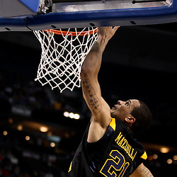 Mar 19, 2011; Tampa, FL, USA; West Virginia Mountaineers guard Joe Mazzulla (21) shoots against the Kentucky Wildcats during the first half  of the third round of the 2011 NCAA men's basketball tournament at the St. Pete Times Forum.  Mandatory Credit: Derick E. Hingle