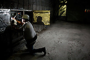 A worker checks electronics systems by headlamp 2150 ft underground inside The Waste Isolation Pilot Plant in Eddy County. WIPP received $172 million as part of the Recovery and Reinvestment Act accelerate nuclear waste cleanup.