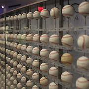 Rows of baseballs signed by Yankees players past and present inside the Yankee Museum at Yankee Stadium before the New York Yankees V Cincinnati Reds Baseball game at Yankee Stadium, The Bronx, New York. 19th May 2012. Photo Tim Clayton