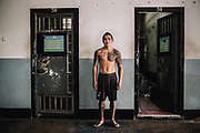 Bangkok  March 2014, Inmates during a Muay Thai (kickboxing) training session at the Klong Prem high-security prison.  Klong-prem Central Prison, or generally called Lad-yao prison, is a high-security prison in Bangkok, taking in custody of male offenders whose sentence term is not over 25 years. With its general capacity to incarcerate offenders (5000+), the prison currently takes in custody of both Thai and foreign nationals. <br /> The inmates is part of a program that pits prisoners against foreign Muay Thai fighters or others inmates for a chance of reduced sentencing or early release. In 2012 an Estonian entrepreneur, in conjunction with Thailand's Department of Corrections, began a series of bouts arranged between Thai prisoners and Western Muay Thai fighters under the banner 'Prison Fight'. For the prisoners a victory holds the potential of time off their sentence while the Westerners fight for a small purse and personal ambition. Since the launch of 'prison fight' a number of prisons have adopted the idea, encouraging prisoners to take up boxing to fight drug abuse and to give them a purpose while incarcerated.