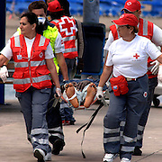 "Tenerife / Los Cristianos June 7, 2006 - A would-be immigrant is carried ashore after arriving with 84 others, at the canary islands - A fishing boat called ""Cayucos"" by the inhabitants of the island, with 85 would-be immigrants from West Africa intercepted by Spanish police of the coast of Tenerife in the Canary Islands are seen in an open wooden fishing vessel as they approach the port of Los Cristianos. They arrived on June, carrying 85 would-be immigrants, in the archipelago which has received more than 7,000 Africans so far this year, more than half to the tourist resort island of Tenerife. At least 1,000 more are believed to have died trying to make the sea crossing, mostly in small fishing boats"