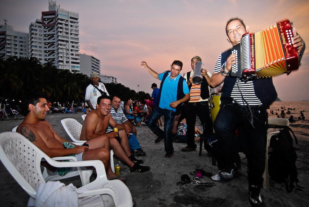 A street band performs on Rodadero Beach in Santa Marta, Colombia.