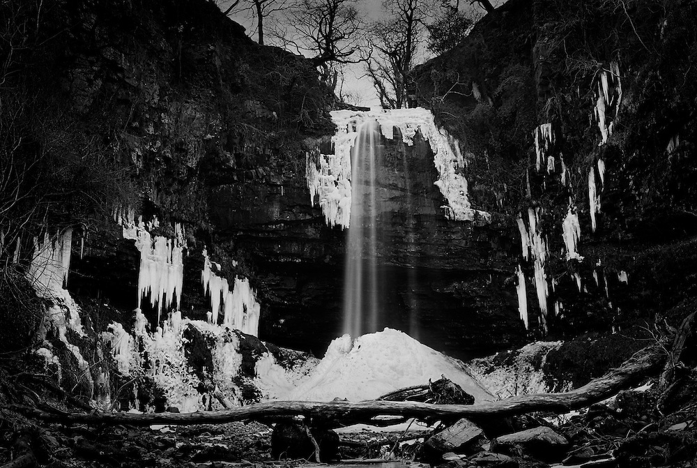Henrhyd Waterfall in deep winter. <br /> The highest waterfall in the Brecon Beacons National Park in Wales.