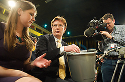 Jo Swinson and Danny Alexander putting money in the bucket to raise funds for the Liberal Democrats party at the Liberal Democrats Annual Party Conference, Brighton, Great Britain, September 26, 2012. Photo by Elliot Franks/i-Images.