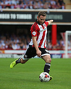 Alan Judge (Brentford midfielder) striking the ball trying to get Brentford back into the game during the Sky Bet Championship match between Brentford and Reading at Griffin Park, London, England on 29 August 2015. Photo by Matthew Redman.
