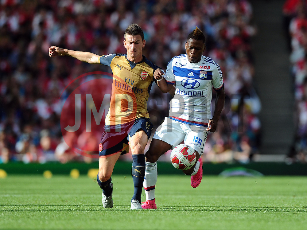 Laurent Koscielny of Arsenal battles for the ball with Clinton Njie of Lyon  - Mandatory by-line: Joe Meredith/JMP - 25/07/2015 - SPORT - FOOTBALL - London,England - Emirates Stadium - Arsenal v Lyon - Emirates Cup