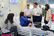 © Licensed to London News Pictures. 24/01/2013. London, UK (Sitting on Left) Daughter of patient Sheree Murphy (On Bed) Patient Heather Murphy (L-R) Andy Burnham, Ed Miliband, Liz Kendall. Leader of the Labour Party, Ed Miliband, Shadow Health Secretary Andy Burnham and Shadow Health Minister Liz Kendall visit the Macmillan Cancer Centre at University College Hospital in Central London today, 24 January 2013. Today the Labour Party launched its Whole Person Care policy review. Photo credit : Stephen Simpson/LNP
