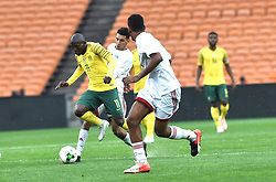 South Africa: Johannesburg: Bafana Bafana player Aubrey Modiba battles for the ball with Seychelles players during the Africa Cup Of Nations qualifiers at FNB stadium, Gauteng.<br />